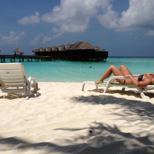Abby, enjoying the sun in the Maldives
